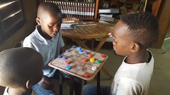 Playing checkers at the library (Lubuto Library Partners) Tags: lubutolibrarypartners lubutolibrary publiclibrary lubuto library africa zambia children youth ovc playing games checkers championship