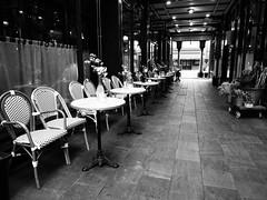 Cardiff Arcade (Hammerhead27) Tags: flowers view pillars ginbar ginjuice glass mono monochrome slates blackandwhite waiting empty chairs tables wales capital city cardiff olympus opening bar restaurant alley mall arcade