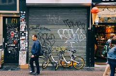 People on the street need a place to go, walking with the beat if it's not too slow.. (erlingraahede) Tags: explore people street bicycles grafitti canon movement poetic amsterdam streetphotography