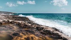 Porto Roxa Beach, Zakynthos (lajosmarkus) Tags: sea beach water colors beautiful landscape greek amazing rocks waves greece porto roxa zante zakynthos clouds cloud ion ionian