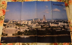 """North Korea vintage P'yongyang tourist brochure/poster circa 1989 - """"It's Always Sunny in P'yang"""" (moreska) Tags: north korea vintage dprk brochure 1989 map poster pyongyang skyline ryugyung hotel pyramid architecture peoples grand study hall retro 1980s daedong river keepsakes souvenirs 80s travel tours ryohaengsa collectibles archive museum asia"""