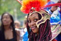 Ekoya at the Leicester Caribbean Carnival (2019) (Nina_Ali) Tags: leicestercaribbeancarnival leicester parade streetparade costume caribbean culture afrocaribbean streetphotography 2019 braids