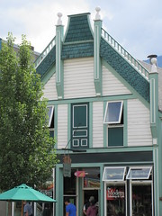 This old shop (trilliumgirl) Tags: revelstoke bc british columbia canada building old facade sky tree white green window