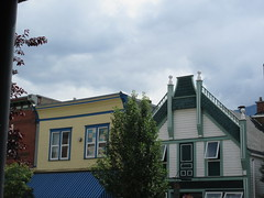 Always look up (trilliumgirl) Tags: revelstoke bc british columbia canada buildings old facade sky trees white green yellow blue