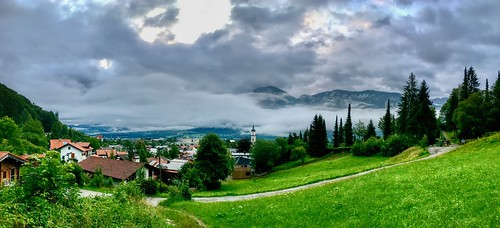 Panorama of Kiefersfelden in the river Inn valley with cloud covered Zahmer Kaiser mountains