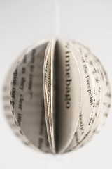 A paperback sphere (Jan.Timmons) Tags: playingwithbooks byjasonthompson cutcircles sewcenter fixsewingmachine oldbook sphere sphericalornament circles5cmdiameter 2inches sewstackof12 fanopen oldpaper handmade nikkor105mmf28macro nikon