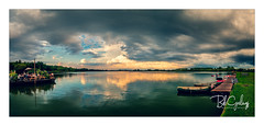 A good day for a lady to turn 60 (Bob Geilings) Tags: clouds rainclouds dramatic bluesky landscape lake sunset water mood netherlands flora fauna boat restaurant