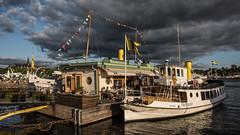 S/S Frithiof vid Ångbåtsbryggan (tonyguest) Tags: ssfrithiof ångbåtsbryggan steamboat boat strandvägen stockholm tonyguest dark clouds sweden water flags motalaexpress
