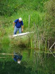 The two of them (peggyhr) Tags: peggyhr reflections lake dsc05593 bluebirdestates alberta canada candid boat cattails dslrautofocuslevel1 dslrautofocuslevel2