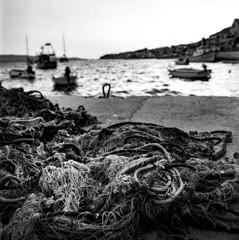 Bol (Samuli Koukku) Tags: croatia brac bol harbour fishing fishingnet pier sea water summer landscape filmphotography film hasselblad zeiss 50mm 500cm epsonv850 6x6 mediumformat bw blackwhite monochrome