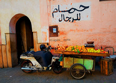 Street market in Marakesh (agrest555) Tags: adult bananas commerce food fruits healthy male man market merchant newspaper read reading sell street wear weighing scale apples baskets crates fresh kiwi marketplace pineapples fruit bike afryka africa marakesh medina old town city marakesz maroko marroco morocco shop shore shopping