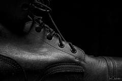 Boot on the Ground (Ian Charleton) Tags: smileonsaturday shoeshow boot combatboot military leather shoelace steeltoe blackandwhite blackbackground lowkey lowangle