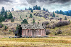The Roof Is The First Thing To Go (rickwil64) Tags: abandoned barn mountains clouds