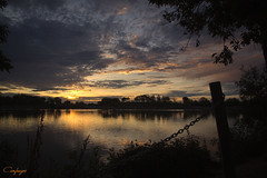 Somos viento...221/365 (cienfuegos84) Tags: sunrise amanecer siluetas nature nubes naranja agua arboles amarillo