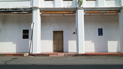 George Town, Penang, Malaysia (Joshua Khaw) Tags: white paint shadows building street sign empty deserted malaysia penang urban city road