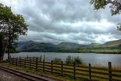 Llanberis lake - Llyn Padarn (Jan 130) Tags: jan130 lake railway narrowguage steamtrain llanberis llynpadarn snowdoniawales northwales emotive fun beautiful topazstudio mountains hills buddleia clouds sky