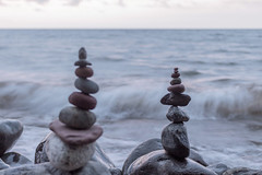 Lake Superior Rock Cairns (Sam Wagner Photography) Tags: rock cairns balanced stacked stack balance peace zen lake superior bokeh motion blur waves water great lakes wisconsin south shore shoreline