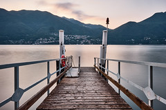 Brienno ferry stop 2 (PascallacsaP) Tags: lagodicomo lario lombardia lombardy como lago lake water shore mountains mountainlake village italia italy alps lakecomo longexposure ndfilter breakthroughfilters breakthroughphotography hills poles ferrystop ferry footbridge lifebuoy serene serenity dawn earlymorning pier comolake jetty 10stop 10stopndfilter