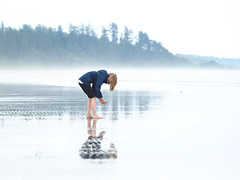 Exploring at the Edge of the World (SGarriott) Tags: sgarriott scottgarriott olympus omd em5ii 40150mmf28 nature canada bc vancouverisland longbeach beach sand ocean sea pacific fog surf girl reflection explore exploring discover westcoast child youth young kid barefoot flickrsbest