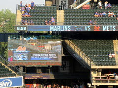 Citi Field, 08/06/19 (NYM v MIA): in the old days, they'd show fans walking down the ramp from the Willets Point-Shea Stadium subway station - now, it's fans walking across the Passerelle Ramp from the Long Island Railroad station (IMG_7954a) (Gary Dunaier) Tags: baseball stadiums stadia ballparks mets newyorkmets flushing queens newyorkcity queenscounty queensboro queensborough citifield