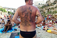 (How To Put Polignano a Mare On The Map) (Robbie McIntosh) Tags: leicam9p leica m9p rangefinder streetphotography 35mm leicam autaut candid strangers leicaelmarit28mmf28iii elmarit28mmf28iii elmarit 28mm seaside tan sand women man polignanoamare puglia streetincolor