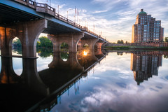 Hanging out in Hartford #6 (tquist24) Tags: connecticut connecticutriver foundersbridge hdr hartford nikon nikond5300 outdoor bridge building city clouds downtown flag flags geotagged light longexposure morning reflection reflections river sky sun sunburst urban water riverwalknorth