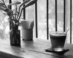 Shaken, Not Stirred (Tim Roper) Tags: hanoi leica vietnam film hc110 hp5 cộng cà phê iced coffee vietnamese travel food analog blackandwhite 28mm elmarit cong caphe cafe