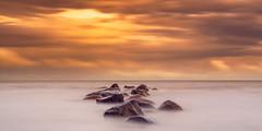 Dreamy Cotton Shores II (Kurt Evensen) Tags: nature leefilter le rockyshore weather vestfold sea haze longexposure beach tønsberg sky seascape shore norway water