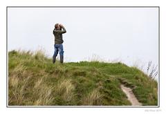 Look to The Sky (Seven_Wishes) Tags: newcastleupontynenortheast northumberland seatonsluice outdoor photoborder canoneos5dmarkiv sigma150600mmf563dgoshsmcontemporary man people candid birdwatcher jeans wellies binoculars grass sandypath newcastleupontyne tyneandwear uk views3k