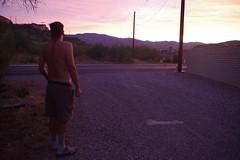 Chad in alley watching sun set (EllenJo) Tags: pentaxks1 2019 august10 sunset arizona verdevalley clarkdale arizonaskies