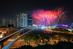 Jurong East Fireworks (Scintt) Tags: singapore sky dramatic travel tourist attraction exploration movement motion skyline cityscape city urban modern structures architecture buildings scintillation scintt jonchiangphotography iconic surreal epic wideangle glow light tones dusk twilight longexposure slowshutter bluehour towers skyscrapers wide night evening business carnival fun celebration trails reflections multipleexplosures fireworks composite blended nationalday ndp festival jurongeast hdb housing estate public apartments residential realestate mrt subway train tracks lighttrail road