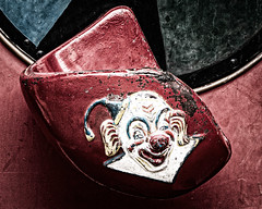 """C'mon Kid - Whaddya Gotta Be Afraid Of?"" (Katrina Wright) Tags: dsc4438edit4 clown fairground amusement ride scary it old beaten weathered worn chipped chippedpaint flakingpaint evil dark haunted evilclown desaturated processed hss sliderssunday"