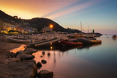 Here for a bit. (Emykla) Tags: giglio toscana tramonto sunset sky cielo nuvole clouds mare sea harbour porto colori colors nikond3100 longexposure evening sera italy italia rocks rocce lighthouse faro tuscany arcipelagotoscano