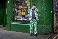 New Tricks (Leanne Boulton) Tags: urban street candid portrait portraiture streetphotography candidstreetphotography candidportrait streetportrait streetlife man male face facepalm hand gesture emotion mood juxtaposition colourful green suit jester joker magician tricks cards fun humour edinburghfestivalfringe2019 fringefestival fringe festival comic character tone texture detail depth naturallight outdoor light shade city scene human life living humanity society culture lifestyle people canon canon5dmkiii 50mm ef2470mmf28liiusm color colour edinburgh scotland uk