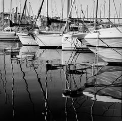 Reflections (suzannesullivan2) Tags: ilforddelta100 r09 bronica water boats reflections marseille film analogue monochrome blackandwhite