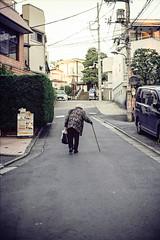 Going Home the Hard Way (RunnyInHongKong) Tags: nikoncoolscan9000 canonef50mmf12l tokyo nikonscan41 ebisu kodakektar100 japan 35mm film canoneos1v