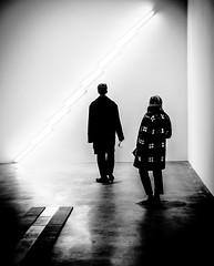 LightAttract.jpg (Klaus Ressmann) Tags: omd em1 fparis france klausressmann winter blackandwhite candid exhibition flcpeop gallery indoor streetphotography unposed omdem1