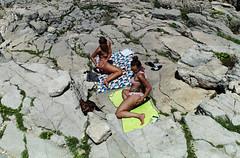 (Symmetry) (Robbie McIntosh) Tags: leicam9p leica m9p rangefinder streetphotography 35mm leicam autaut candid strangers leicaelmarit28mmf28iii elmarit28mmf28iii elmarit 28mm seaside tan sand women man polignanoamare puglia streetincolor