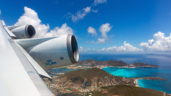 Departing St. Maarten. (spencer_wilmot) Tags: klm kl klklm royaldutchairlines boeing b747 747 747400 744 flaps leadingedge engines sxm tncm sxmtncm stmaarten sintmaarten saintmartin caribbean turquoise turqouise takeoff departure boeing747 jet jetliner jumbo jumbojet doubledecker windowview climbout clouds flying flight plane passengerjet civilaviation commercialaviation aviation aircraft airplane airliner airport powerplant thrust huge heavy widebody winglets pilot quad queenoftheskies runway princessjuliana