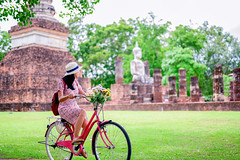 DAN_3046 (Mangpink) Tags: tourist woman one blackhair bag walking hat sukhothaihistoricalpark grassfields green ride bicycle flower architecture asia asian unesco tourism wat historical temple travel buddhist culture religion pagoda ancient sky landmark thailand building old buddha heritage palace famous park capital clouds statue destination exterior traditional structure stone ruins blue