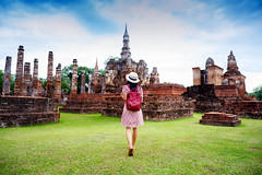 DAN_3380 (Mangpink) Tags: tourist woman one blackhair bag walking hat sukhothaihistoricalpark grassfields green architecture asia asian unesco tourism wat historical temple travel buddhist culture religion pagoda ancient sky landmark thailand building old buddha heritage palace famous park capital clouds statue destination exterior traditional structure stone ruins blue look alone