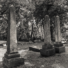 Three Obelisks (Jim Frazier) Tags: old trees summer blackandwhite bw sculpture cemeteries art heritage history texture monochrome cemetery grass dark square illinois scary shadows gloomy sad graveyards stones lawn cook statues dreary sunny august eerie graves historic haunted creepy il pylon spooky worn obelisk gravestone mysterious limestone historical weathered balance desaturated aged elgin melancholy monuments pillars statuary ghostly tombstones monolith somber tombs atmospheric q3 gravesites memorials afternoonlight verticals ruleofthirds 2019 bluffcitycemetery ruleofodds jimfraziercom gravesmarkers 20190810bluffcitycemetery loadcode201908 jfpblog instagram