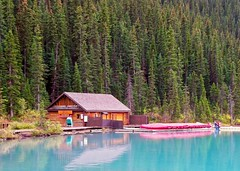 Boathouse (brucecarlson66) Tags: lake louise boat canoe house forest pine fir tree blue green bluegreen turquoise water albert canada log cabin wood fence peaceful peace still beauty vacation tourist attraction glacial silt powder color reflection tranquil tranquility serenity