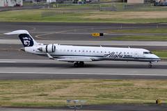 Alaska Airlines (SkyWest Airlines) - Bombardier (Canadair) CRJ-701ER (CL-600-2C10) - N223AG - Portland International Airport (PDX) - June 3, 2015 5 451 RT CRP (TVL1970) Tags: nikon nikond90 d90 nikongp1 gp1 geotagged nikkor70300mmvr 70300mmvr aviation airplane aircraft airlines airliners portlandinternationalairport portlandinternational portlandairport portland pdx kpdx n223ag alaskaairlines horizonair horizon alaskaairgroup n602qx frontierairlines zsnlv southafricanexpressairways skywestairlines skywest bombardieraerospace bombardier bombardiercrj700 bombardiercrj701 bombardiercrj701er bombardiercrj canadair challenger cl600 cl6002c10 crj crj700 crj701 crj701er regionaljet generalelectric ge cf34 cf348c5 cf348c5b1 thrustreverser thrustreversers
