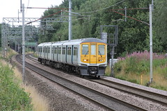Former Thames link 319373 on loan to Northern Rail approaches Bridge 60A at Standish with 1N86 Liverpool LS to Blackpool North on 11th August 2019 © (steamdriver12) Tags: former thames link 319373 loan northern rail bridge 60a lancashire standish 1n86 liverpool lime street blackpool north 11th august 2019 emu electric multiple unit england west coast main line