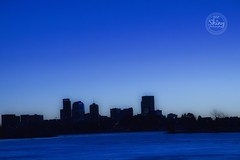Blue edit of a cloudless sunrise reflecting off the frozen lake with the city skyline in silhouette. Taken on 2-2-19, at Sloan's Lake in Denver, Colorado.  ~ ~ ~ ~ ~  #CanonRebelT5 #Canon #Rebel #T5 F/11 87mm 1/160s ISO-3200 #blue #edit #cloudless #sunris (oooshinyphotography) Tags: sunrise hashtagcolorado color city canonrebelt5 sloanlake skyline coloradoshared citycaptures coloradotography canon oooshiny cityskyline colorcaptures frozenlake t5 coloradolove rebel edit frozen cloudless coloradocreative coloradophotography oooshinyphotography viewcolorado blue coloradophotographer silhouette coloradocollective lake