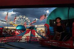 you can make up your own title (oldogs) Tags: fair flag usflag ferriswheel carnival carnivalride girl clouds