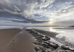 Where the clouds and rock meet (Jo Evans1 - off and on for a while) Tags: dunraven bay south glamorgan sunset rocks beach calmness tranquility