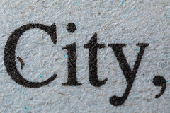 newsprint, 5x (jlodder) Tags: macromondays printedword newspaper newsprint 5x city word cropped