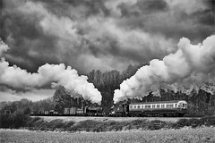 Steam trains passing at Kinchley Lane (Iand49) Tags: transport railway railroad rail trains goodstrain vans trucks wagons freight autocoach greatwestern steam locomotives engines kinchleylane swithland leicestershire england europe mainline trees woodland countryside rural darksky stormy moody atmospheric exhaust passing crossing power speed motion historic heritage nostalgia evocative preservation restored monochrome blackandwhite